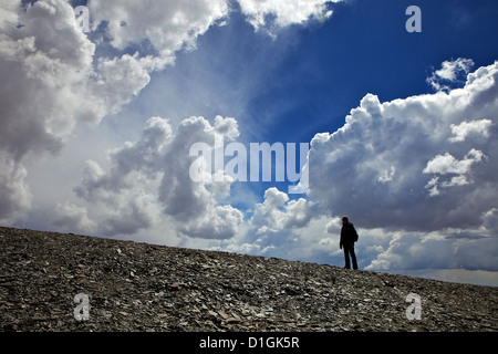 Climber In the clouds Mount Chacaltaya, Cordillera real, Bolivia, Andes, South America - Stock Photo