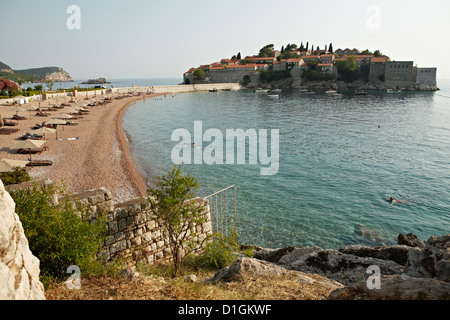 The small islet of Sveti Stefan, now an exclusive Aman hotel resort, Budva, Montenegro, Europe - Stock Photo