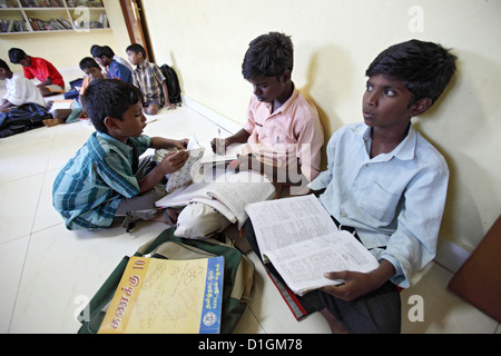 Chennai, India, a young boy in the orphanage does his homework - Stock Photo