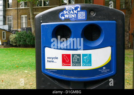 A bottle and can recycling bank with a competition entered by scanning a QR code by mobile 'phone. - Stock Photo