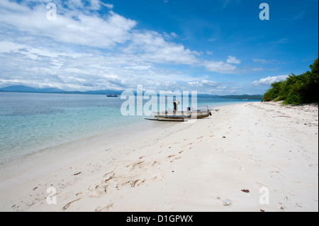 Beach with fishing boat, Manado, Sulawesi, Indonesia, Southeast Asia, Asia - Stock Photo