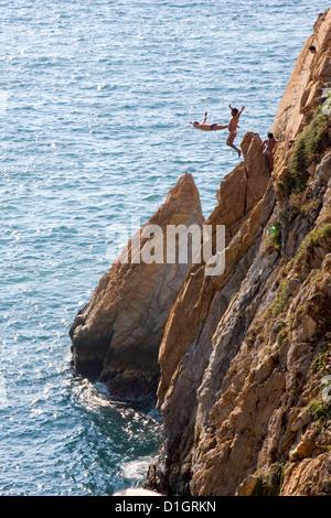 Cliff Divers jump at La Quebrada, Acapulco, Guerrero, Mexico. - Stock Photo