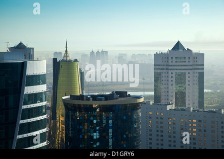 View of city looking towards twin golden conical business centre and House of Ministries, Astana, Kazakhstan, Central - Stock Photo