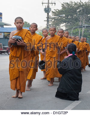 Young Buddhist monks collecting alms in the morning, Ayutthaya, Thailand, Southeast Asia, Asia - Stock Photo