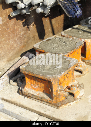 Samples of concrete in cube molds prepared for compressive strength test on road construction site - Stock Photo