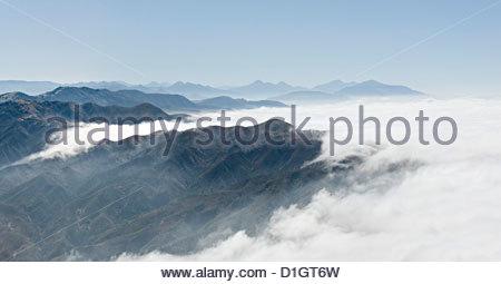 Aerial photo of clouds and Malibu Canyon, Ventura, California, United States of America, North America - Stock Photo