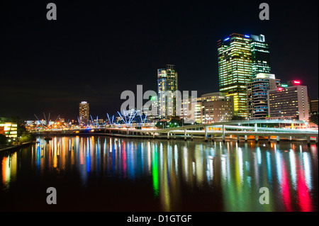 Colourful reflection of city skyline in Brisbane River at night, Brisbane, Queensland, Australia, Pacific - Stock Photo