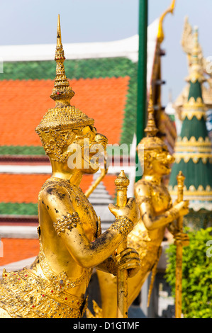 Two gold guardian statues, at the Grand Palace, Bangkok, Thailand, Southeast Asia, Asia - Stock Photo