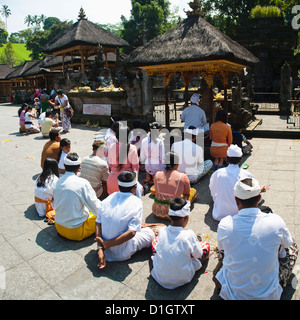 Group of Hindu people praying at Pura Tirta Empul Temple, Bali, Indonesia, Southeast Asia, Asia - Stock Photo