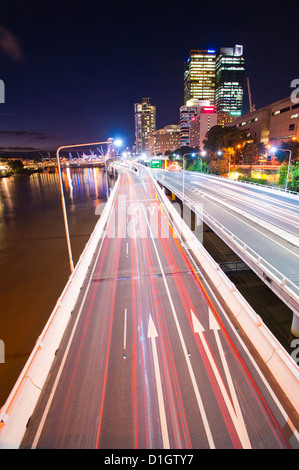 Car light trails at night on a highway in Brisbane, Queensland, Australia, Pacific - Stock Photo