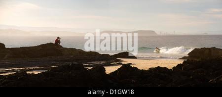 Australian man watching surfers at Tweed Heads, Gold Coast, Queensland, Australia, Pacific - Stock Photo