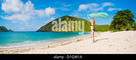 Woman celebrating freedom at Mawun Beach, a Tropical Paradise in South Lombok, Indonesia, Southeast Asia, Asia - Stock Photo