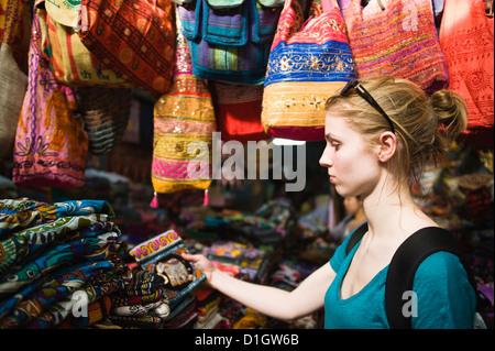 Tourist shopping on the Khaosan Road Market in Bangkok, Thailand, Southeast Asia, Asia - Stock Photo
