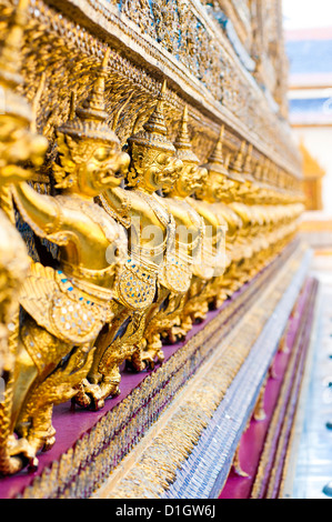 Guardian statues at Temple of the Emerald Buddha (Wat Phra Kaew), The Grand Palace, Bangkok, Thailand, Southeast - Stock Photo