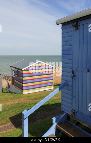 Colourful wooden beach huts overlooking the Thames estuary on north Kent coast in Tankerton, Whitstable, Kent, England, - Stock Photo