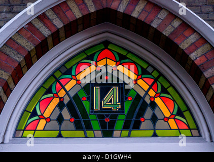 Number 14 in a London stainedglass window above entrance - Stock Photo