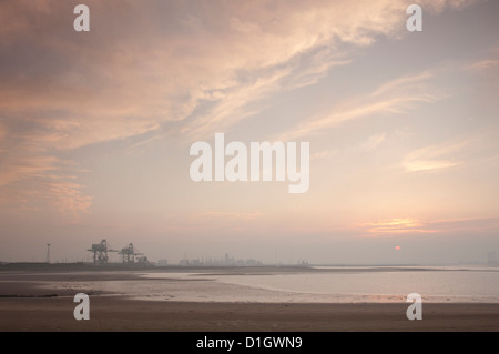 Teesside heavy industry seen from the South Gare of the River Tees at sunset. - Stock Photo