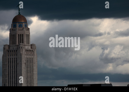 Nebraska State Capitol building with a thunderstorm behind. - Stock Photo