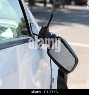 Damaged car and broken side rear view mirror. - Stock Photo