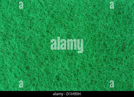 Green abrasive sponge texture background - Stock Photo