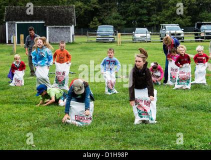 Sack race at the Martha's Vineyard Harvest fest, West Tisbury, Massachusetts, USA - Stock Photo