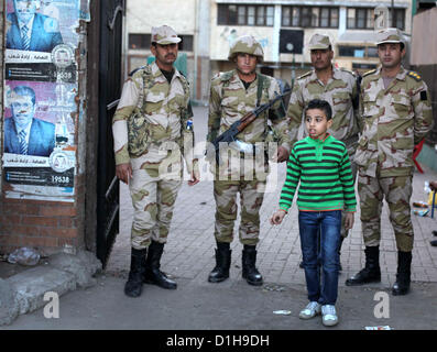 Dec. 22, 2012 - Cairo, Cairo, Egypt - Members of Egyptian army stand guard at the entrance of the polling station, - Stock Photo