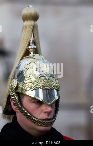 The Queens Household Cavalry close up of his helmet - Stock Photo