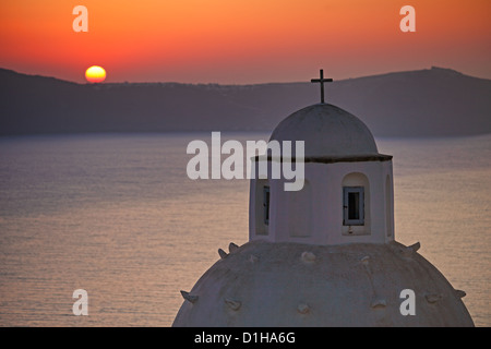The sunset from Agios Minas in Fira which is the capital of Santorini island, Greece - Stock Photo