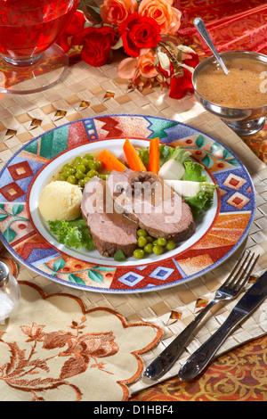 Sliced Roast Beef with salad and puree - Stock Photo