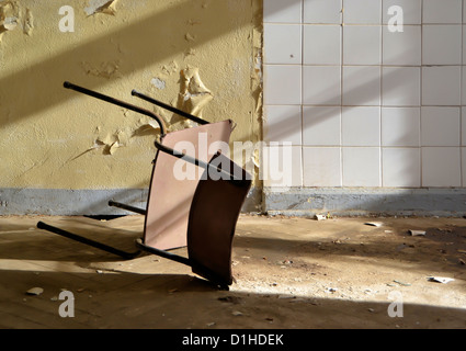 Chair in an abandoned building - Stock Photo
