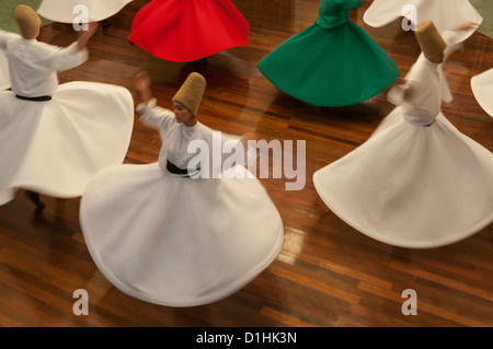 Whirling Dervishes perform in the  Mevlevihane,istanbul,Turkey - Stock Photo
