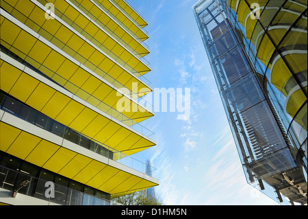 Distant photograph of the Shard behind yellow building, as seen from Angel Lane, London EC4. - Stock Photo