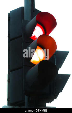 green and yellow traffic control signal isolated on white - Stock Photo