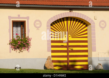 Farmstead gate in Holasovice, South Bohemia, Czech Republic - Stock Photo