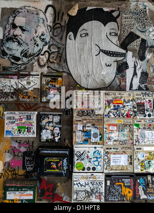 Mail boxes are covered in Graffiti and street art - Inner Courtyard of Haus Schwarzenberg, 39 Rosenthalerstrasse, - Stock Photo