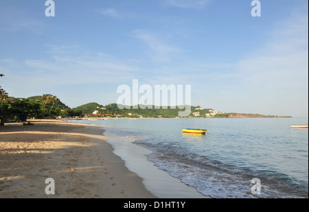 Blue sky view yellow sand, waves, small boats, Grand Anse Beach, south to Quarantine Point, St George's, Grenada, - Stock Photo