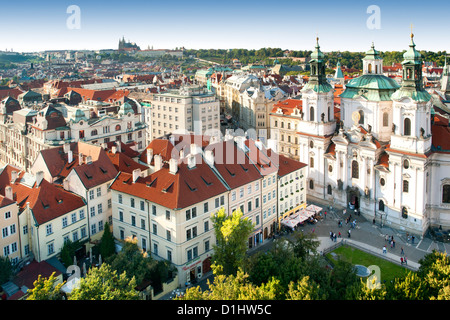 View of St Nicholas' church and old town rooftops in Prague, the capital of the Czech Republic. - Stock Photo