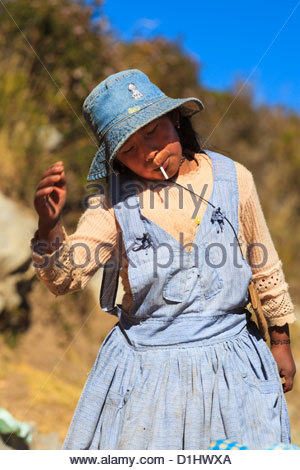 Girl playing on Isla del Sol on the Bolivian Side of Lake Titicaca, Bolivia. Photo: Navè Orgad - Stock Photo