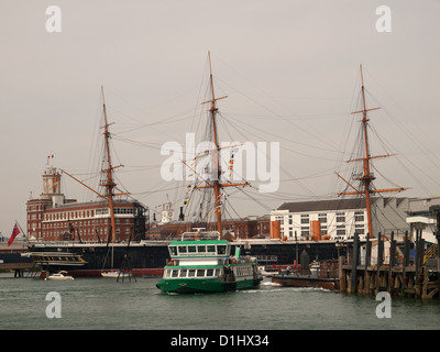 HMS Warrior and Gosport ferry Portsmouth Harbour Hampshire England UK - Stock Photo