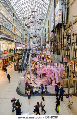 Christmas shoppers and decorations in The Eaton Centre a multi level downtown shopping mall in Toronto Ontario Canada - Stock Photo