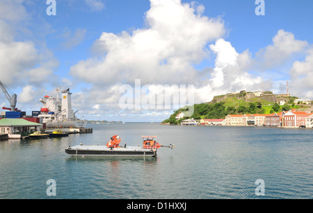 Blue sky white clouds view, to Fort George, small barge, container ship moored, St George's Harbour, Grenada, West - Stock Photo