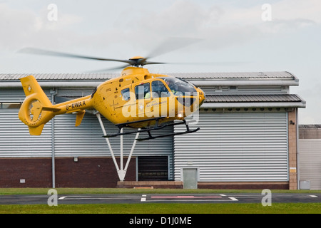 North West Air Ambulance helicopter lifts off from the heli-pad at Royal Preston Hospital, Lancashire - Stock Photo