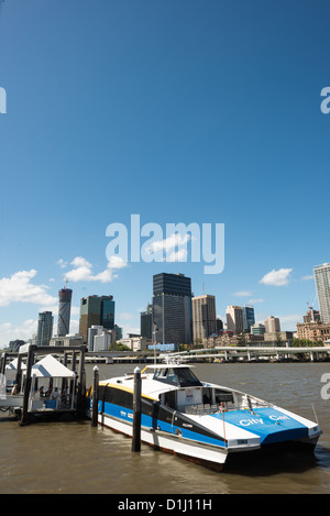 BRISBANE, Australia - A Citycat ferry pulled up to a ferry terminal at South Bank, with the Brisbane city skyline - Stock Photo