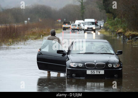 Derwenlas, Ceredigion Wales UK. Monday 24 December 2012. Cars driving through floodwaters on the A487 trunk road - Stock Photo