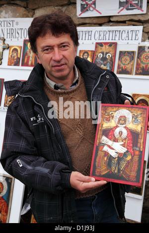 Icon painter Tzvetan Hristov outside of the Nativity Church at Arbanassi, close to Veliko Tarnovo, Bulgaria. - Stock Photo