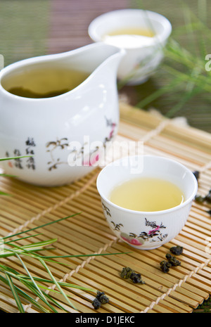 Oolong Tea in traditional tea pot and cups - Stock Photo
