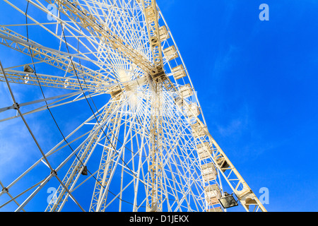 White Ferries Wheel in front of blue sky - Stock Photo