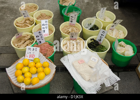 Pickled vegetables on a marked in Japan with white raddish - Stock Photo