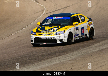 A Scion tC competes in the  CTCC Canadian Touring Car Championship at the 2011 Mobile-1 Grand Prix Mosport - Stock Photo
