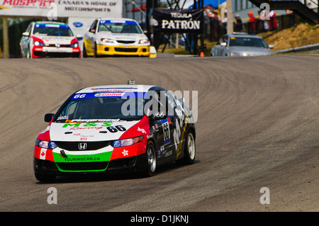 A Honda Civic competes in the  CTCC Canadian Touring Car Championship at the 2011 Mobile-1 Grand Prix Mosport - Stock Photo